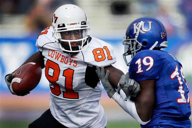 Oklahoma State wide receiver Justin Blackmon (81) is tackled by Kansas cornerback Isiah Barfield (19) on Nov. 20, 2010.