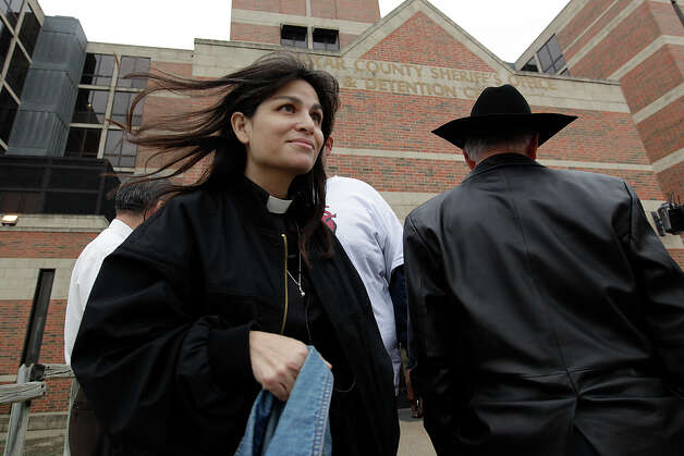 United Methodist minister Lorenza Andrade-Smith is released from the Bexar County Jail on Tuesday, Dec. 7, 2010 after bail was posted. Andrade-Smith was one of 16 DREAM Act supporters arrested on Nov. 29 on trespassing charges after they took over U.S. Sen. Kay Bailey Hutchison's office at Port San Antonio. Although the other college students and community activist arrested were bailed out after spending a night a jail, Andrade-Smith chose to stay jailed until now. Helping her is Rev. Francisco Campos, the Rio Grande Conference of the United Methodist Church Central District Superintendent. Photo: Jerry Lara/Express-News