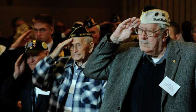 "Pearl Harbor Survivor Seaman Charlie Ebel, right, flanked by Steve Danish, center, and Pearl Harbor Survivor Carpenters Mate 1st Class Robert Grimm, left, salute during the playing of ""Taps"" at the Pearl Harbor Day Memorial Observance at the J. E. Zaloga Post of the American Legion Dec. 7.    (Skip Dickstein / Times Union) Photo: SKIP DICKSTEIN / 2008"