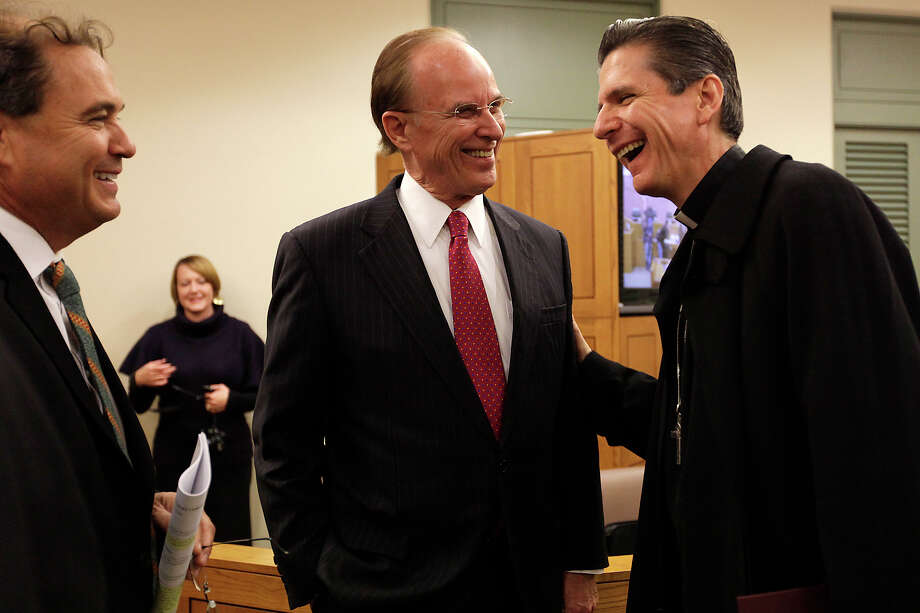 "Archbishop Gustavo García-Siller talks with Bexar County Commissioner Sergio ""Chico"" Rodriguez (left) and County Judge Nelson Wolff during a visit to the commissioners' meeting. Photo: JERRY LARA/glara@express-news.net"