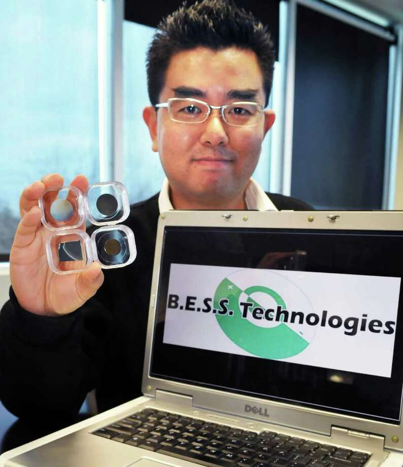 Jae Ho Lee, lead material engineer for the CNSE start-up company B.E.S.S. Technologies with prototypes of lithium ion battery anodes at Albany NanoTech Tuesday afternoon December 7, 2010.  (John Carl D'Annibale / Times Union) Photo: John Carl D'Annibale / 00011326A