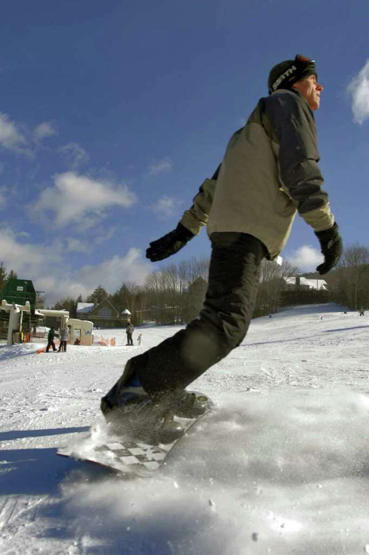 Windham Mountain contends unfair competition from state-run Belleayre as a snowboarder shows his prowess on the snowboard at the private operation. (PHILIP KAMRASS/TIMES UNION archive)