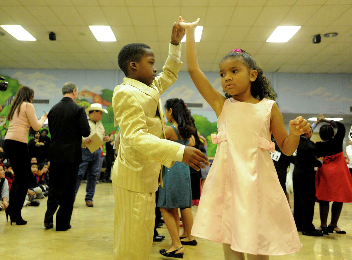 Alizay Sullens and Rakeem Asmore perform during a ballroom dance competition at LBJ Elementary School on Tuesday, Dec. 7, 2010.