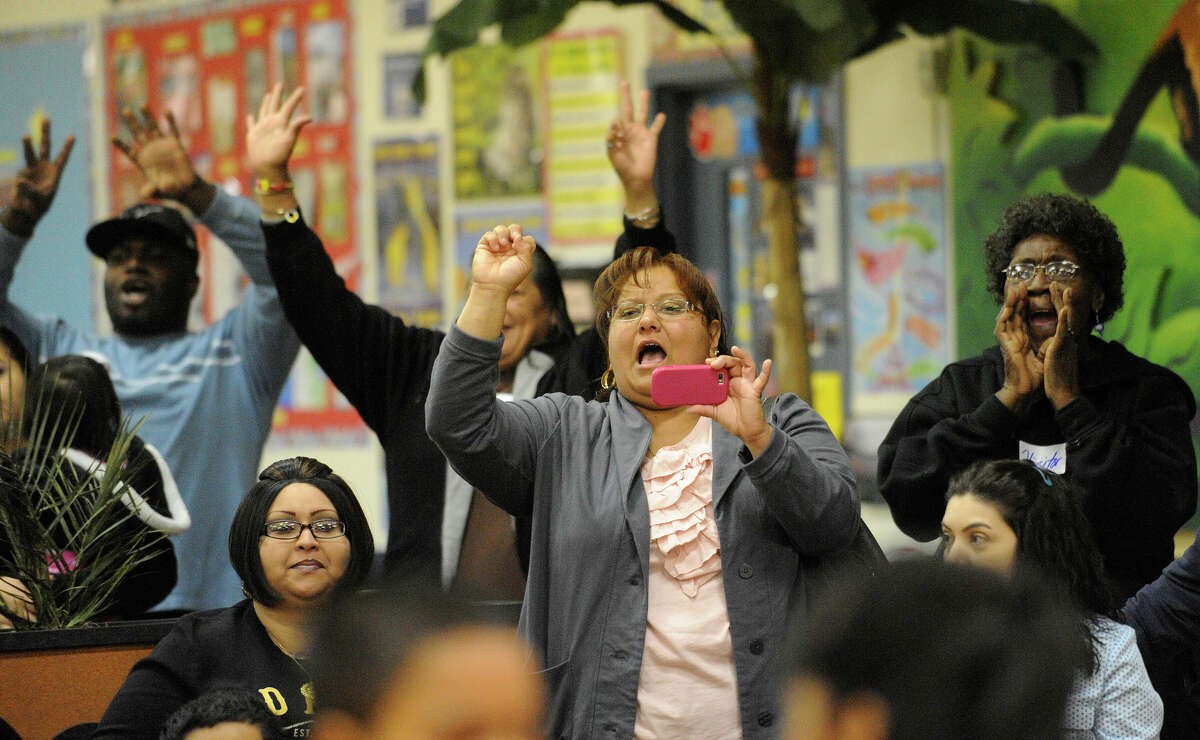 Parents cheer for their children during a ballroom dance competition at LBJ Elementary School on Tuesday, Dec. 7, 2010.