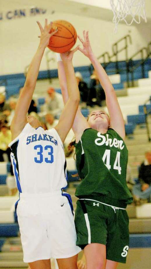 Shaker's Mackenzie Rowland, left, goes up for the rebound against Shenendehowa's Allie Setter on Tuesday, Dec. 7. (Luanne M. Ferris / Times Union ) Photo: Luanne M. Ferris