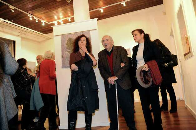 Woodcut artist Antonio Frasconi, now 91, in center, attends a retrospective exhibit of his work as well as his late wife Leona Pierce's work, at the Center for Contemporary Printmaking in Norwalk, Conn. on Thursday November 2, 2010. At left of Frasconi is his former student Ilse Schreiber-Noll, of Terrytown. Ar right is his caretaker Sandra Pelaez. Photo: Christian Abraham / Connecticut Post