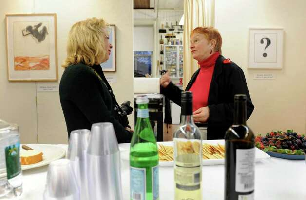 Michele Frentrop, left, of Ridgefield, and Marcia Powell, of Norwalk, chat during a retrospective exhibit of woodcut artist Antonio Frasconi and his late wife Leona Pierce's work, which was held at the Center for Contemporary Printmaking in Norwalk, Conn. on Thursday November 2, 2010. Photo: Christian Abraham / Connecticut Post