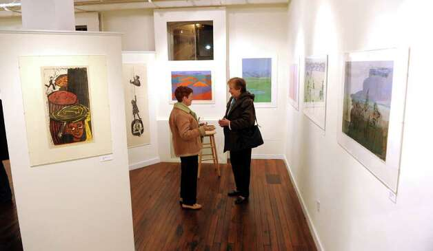 Lydia Menendez, of Fairfield, left, and friend Alicia Hayes, of Ridgefield, chat during a retrospective exhibit of woodcut artist Antonio Frasconi and his late wife Leona Pierce's work, which was held at the Center for Contemporary Printmaking in Norwalk, Conn. on Thursday November 2, 2010. Photo: Christian Abraham / Connecticut Post