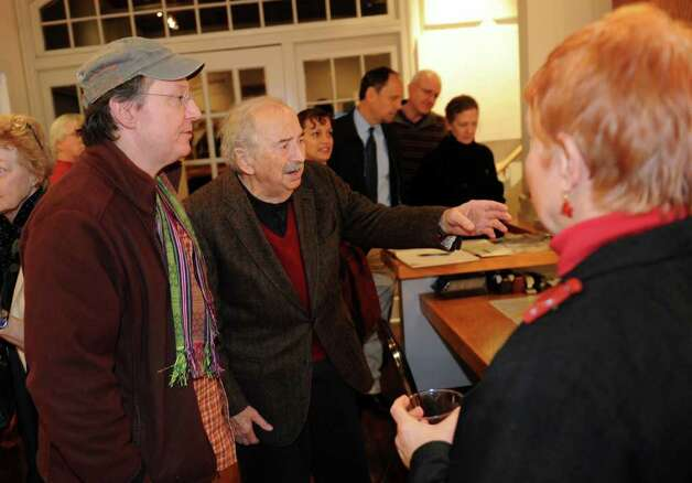 Woodcut artist Antonio Frasconi, center, and his son Miguel, attend an exhibit of his and his late wife Leona Pierce's work, which was held at the Center for Contemporary Printmaking in Norwalk, Conn. on Thursday November 2, 2010. Photo: Christian Abraham / Connecticut Post