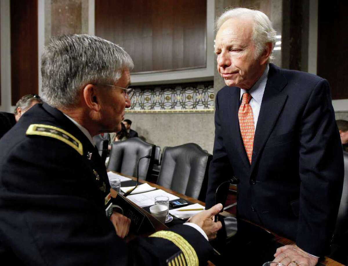 Senate Armed Service Committee Sen. Joseph Lieberman, I-Conn., right, talks with Army Chief of Staff Gen. George Casey Jr., on Capitol Hill in Washington Friday, Dec. 3, 2010, before the start of the committee's hearing on the military Don't Ask Don't Tell policy. (AP Photo/Alex Brandon)