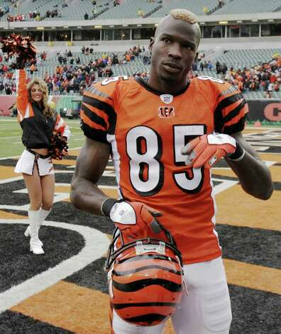 "Cincinnati Bengals receiver Chad Johnson, wearing a mohawk,  is shown in this file photo after a win over the Carolina Panthers in an NFL football game Sunday, Oct. 22, 2006, in Cincinnati. Johnson sat down to watch film of the Oakland Raiders' cornerbacks and was surprised by what he saw. ""They are blanketing everybody they play, everybody they play,"" Johnson said Wednesday, Dec. 6, 2006, in a conference call with Bay Area reporters. (AP Photo/David Kohl) Photo: DAVID KOHL, STR / Beaumont"