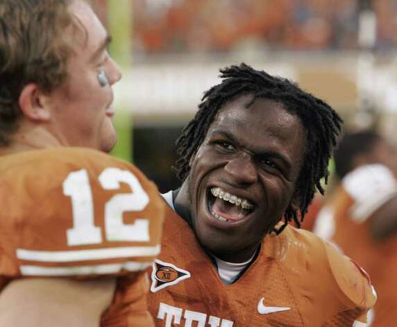 Texas running back Jamaal Charles, sporting his trademark dreadlocks,  looks toward quarterback Colt McCoy, left, after their 28-25 victory over Nebraska in their college football game Saturday, Oct. 27, 2007, in Austin, Texas. Charles ran for fourth-quarter touchdowns of 25, 86 and 40 yards to carry No. 17 Texas to the victory, sending Nebraska to their fourth-straight loss.  (AP Photo/Harry Cabluck) Photo: Harry Cabluck, STF / Beaumont