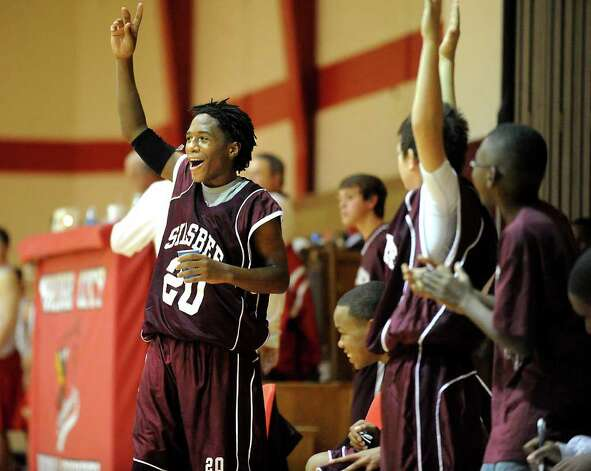 Silsbee Middle School's Tavaris Brooks celebrates a win against Bridge City Middle School in Bridge City, Thursday. Brooks may have to cut his dreadlocks in order to be compliant with the new Silsbee Middle School basketball dress and behavior code policies. Tammy McKinley/The Enterprise Photo: TAMMY MCKINLEY / Beaumont