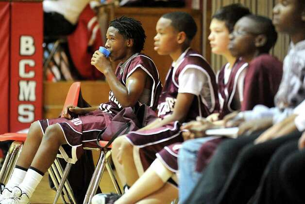 Silsbee Middle School's Tavaris Brooks watches as his team plays against Bridge City Middle School in Bridge City, Thursday. Brooks may have to cut his dreadlocks in order to be compliant with the new Silsbee Middle School basketball dress and behavior code policies. Tammy McKinley/The Enterprise Photo: TAMMY MCKINLEY / Beaumont