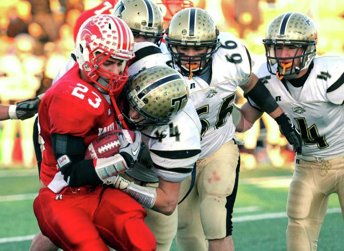 Highlights from Class LL semifinal football action between Norwich Free Academy and Trumbull in West Haven, Conn. on Saturday December 4, 2010. Trumbull beat Norwich 21-6. Trumbull's #44 Don Cherry tackles norwich's #23 Tony Facchini.
