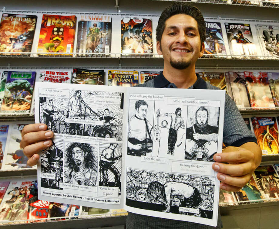 "Chris Navarro shows off issue Nov. 1 of his new comic book ""Chicano Superstar"" at Collectors Authority, 1534 S.E. Military Dr.Photo by Marvin Pfeiffer"