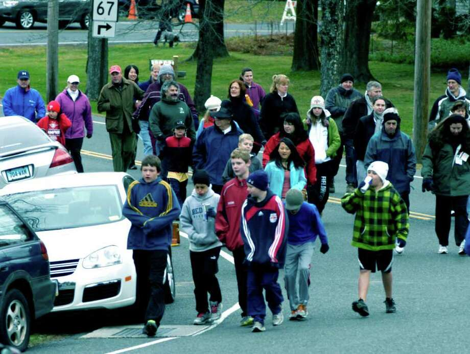 Run for a Cure race attracts record field Southbury athletes earn