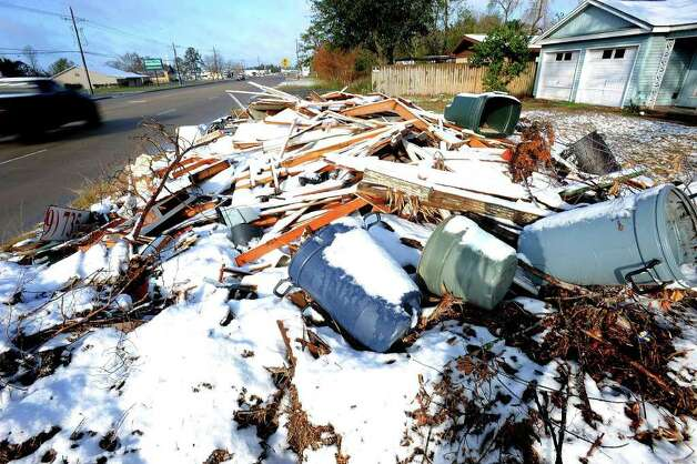 Snow rests on a pile of Hurricane Ike debris at a Bridge City home on Thursday, December 11, 2008. Guiseppe Barranco/The Enterprise / Beaumont