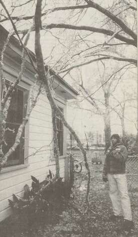 """Kevin Rogers waits for an Entergy crew after a frozen bough landed onthe power line to his Old Town house."" File photo Jan. 14, 1997"