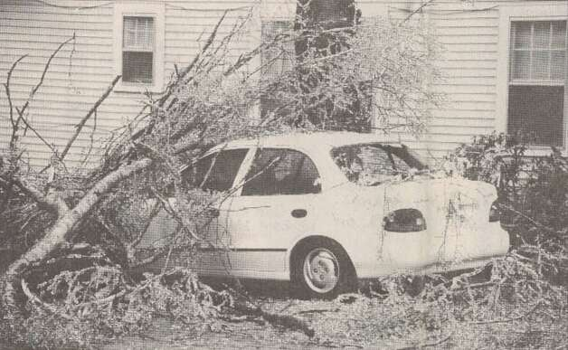 """Ice-laden limbs fell on this car parked in a driveway on Amarillo Street."" File photo Jan. 14, 1997"