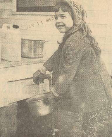 """Joan McAlpin, 5, daughter of Mr. and Mrs. R. E. McAlpin in Vidor, fills a pan with water at a yard faucet. Other water pipes and drains were frozen early yesterday by 16 degree weather. Scenes such as this were common throughout Vidor and the area yesterday."" File Photo Jan. 10, 1962"