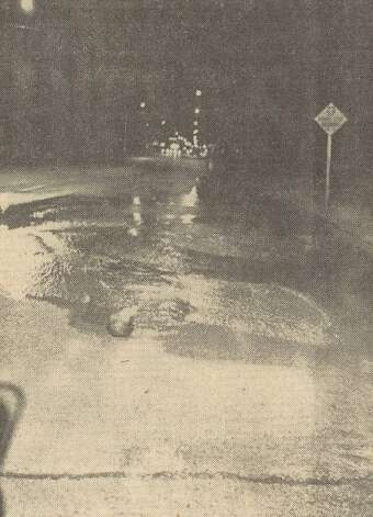 A 20-foot square chunk of Calder Avenue at 13th Street detached itself from the rest of the pavement allowing water to gush. File photo Jan. 10, 1962