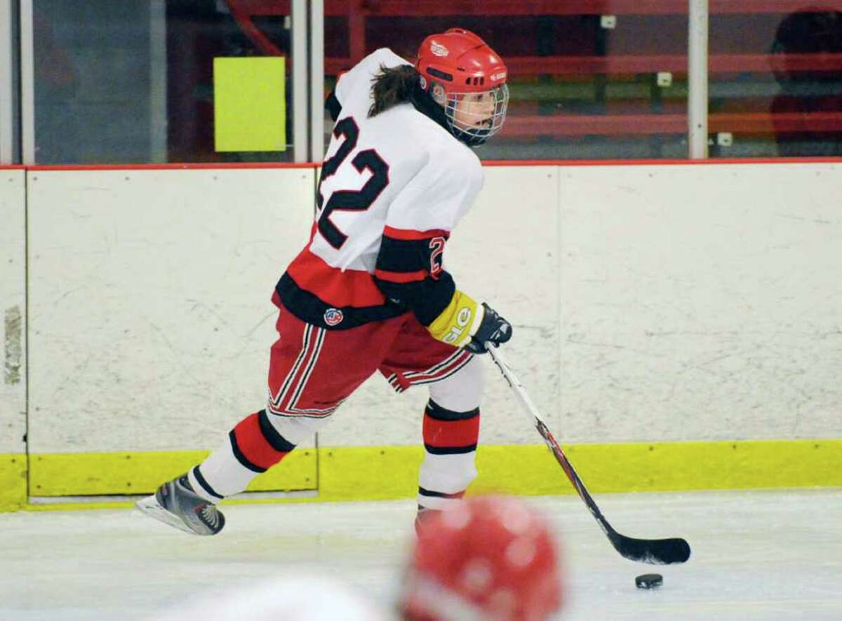 Olivia Hompe, # 22 of New Canaan High School in action during game against Greenwich High School at Darien Rink, Wednesday, Dec. 8, 2010.