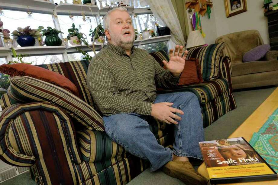 Patrick Ellis, a state employee, talks about his efforts to confirm that his paycheck-deducted contributions for Operation Smile actually reached that charity in his Delmar home. ( Michael P. Farrell/Times Union ) Photo: Michael P. Farrell
