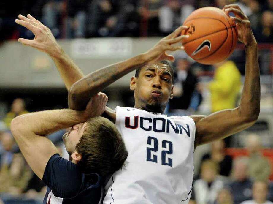 Connecticut's Roscoe Smith, right, is fouled by Fairleigh Dickinson's Kamil Svrdlik during the first half of an NCAA college basketball game in Storrs, Conn., on Wednesday, Dec. 8, 2010. (AP Photo/Fred Beckham) Photo: AP