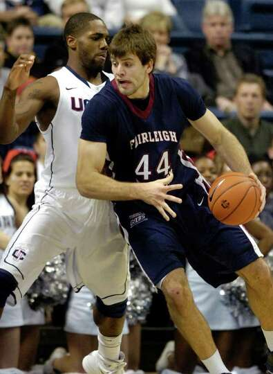 Connecticut's Alex Oriakhi, left, guards Fairleigh Dickinson's Kamil Svrdlik during the first half o