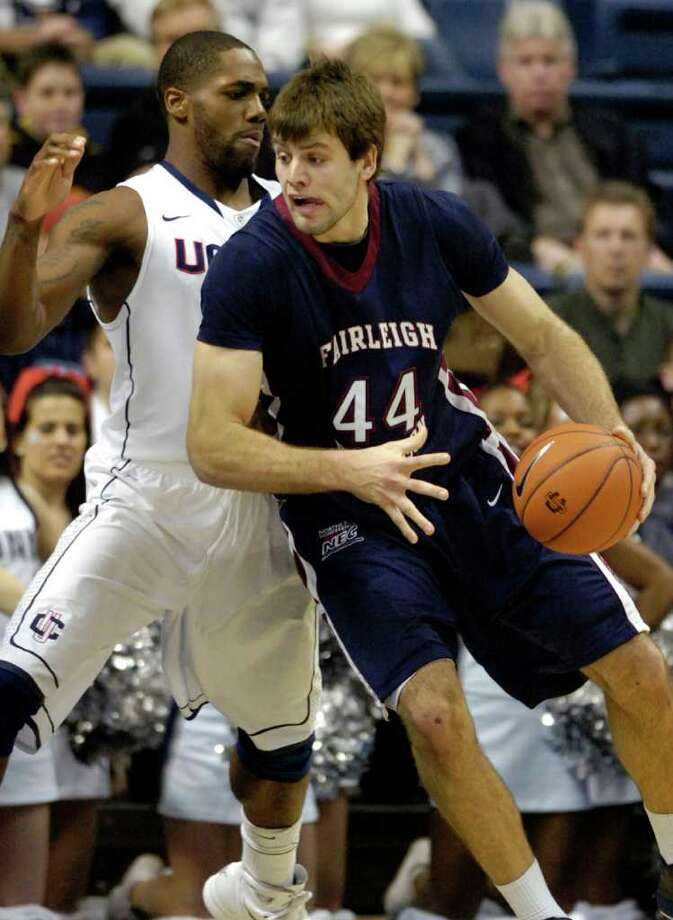 Connecticut's Alex Oriakhi, left, guards Fairleigh Dickinson's Kamil Svrdlik during the first half of an NCAA college basketball game in Storrs, Conn., on Wednesday, Dec. 8, 2010. (AP Photo/Fred Beckham) Photo: AP