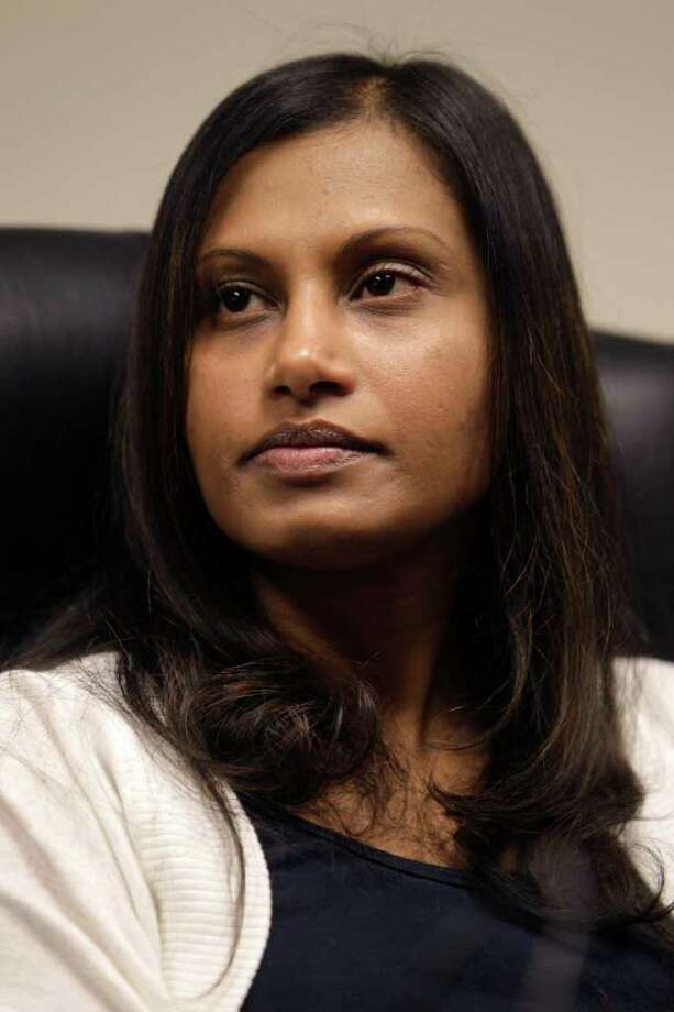 Seemona Sumasar attends a news conference in Mineola, N.Y., Wednesday, Dec. 8, 2010. Sumasar, who says she was raped by her ex-boyfriend Jerry Ramrattan, contends she was victimized a second time when he set up an elaborate ruse to frame her for armed robberies she did not commit. Sumasar was released last week after spending nearly seven months in a Long Island jail on the robbery charges. (AP Photo/Seth Wenig) Photo: Seth Wenig