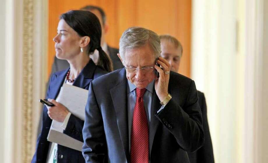 Senate Majority Leader Sen. Harry Reid of Nev. talks on the phone as he walks to their Senate Democratic caucus on Capitol Hill in Washington Wednesday, Dec. 8, 2010. (AP Photo/Alex Brandon) Photo: Alex Brandon