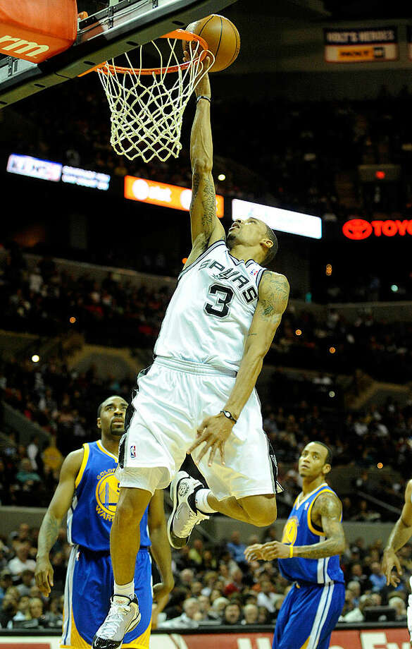 The Spurs' George Hill scores on a breakaway during first-half action against the Warriors at the AT&T Center on Wednesday. BILLY CALZADA/gcalzada@express-news.net