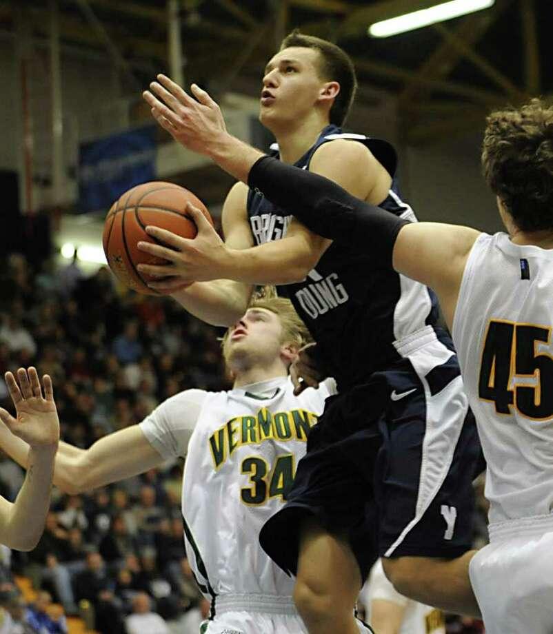 Kyle Collinsworth of BYU makes his way, through Vermont players to the basket.  (Lori Van Buren / Times Union) Photo: Lori Van Buren