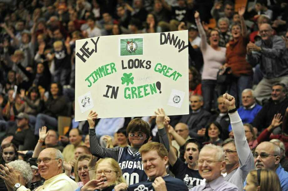 A fan of BYU's Jimmer Fredette, a graduate of Glens Falls, holds a sign for Danny Ainge to see at a basketball game against Vermont. Ex-Celtic basketball great Danny Ainge was in the crowd. (Lori Van Buren / Times Union) Photo: Lori Van Buren