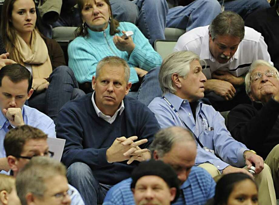 Former Boston Celtics starr Danny Ainge, center, watches Jimmer Fredette, a graduate of Glens Falls, play in a basketball game against Vermont at the Glens Falls Civic Center. Fredette's father, top right, talks to a fan front of him. (Lori Van Buren / Times Union) Photo: Lori Van Buren
