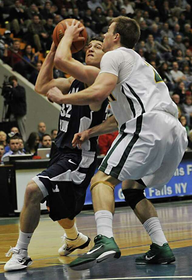 Jimmer Fredette of BYU drives against Vermont's Brendan Bald. Fredette scored 26 in the game. (Lori Van Buren / Times Union) Photo: Lori Van Buren