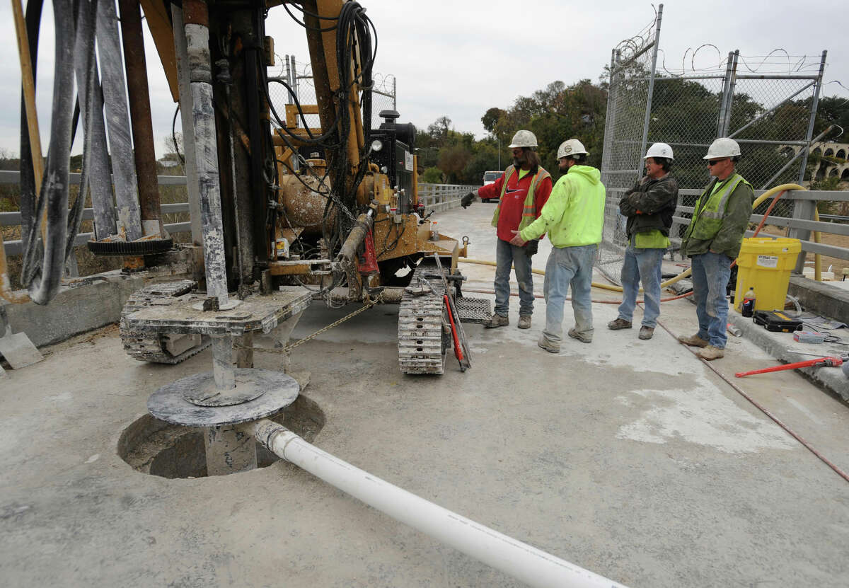 A work crew drills a hole into Olmos Dam, part of the process to strengthen it. The dam was built in the 1920s and prevents flooding of downtown San Antonio.