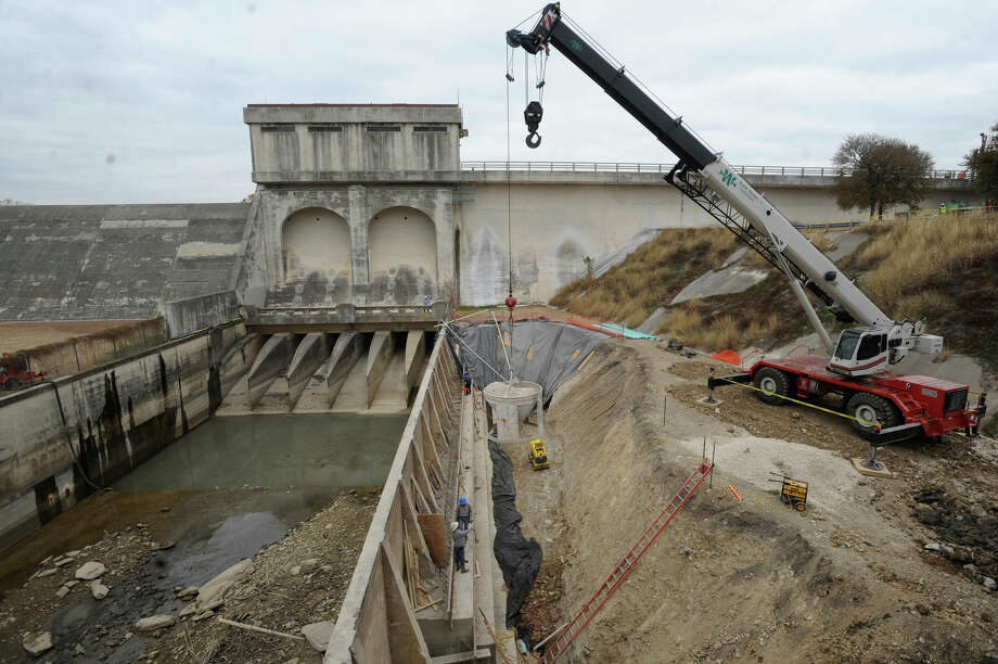 For the first time in three decades, the Olmos Dam is getting a significant upgrade. Workers are drilling top-to-bottom holes through the concrete structure and into the bedrock below to install 68 cable tendons that will help anchor the dam even more securely. Construction manager Ted Nelson said the work is needed because the dam is impounding more floodwaters than ever because of increased runoff from population-growth areas on the North Side. He noted that after relatively modest rainfall in September, the structure had 28 feet of water backed up behind it. Olmos Dam was built after a deadly flood in 1921 left most of downtown underwater. Photo: BILLY CALZADA/gcalzada@express-news.net / SAN ANTONIO EXPRESS-NEWS
