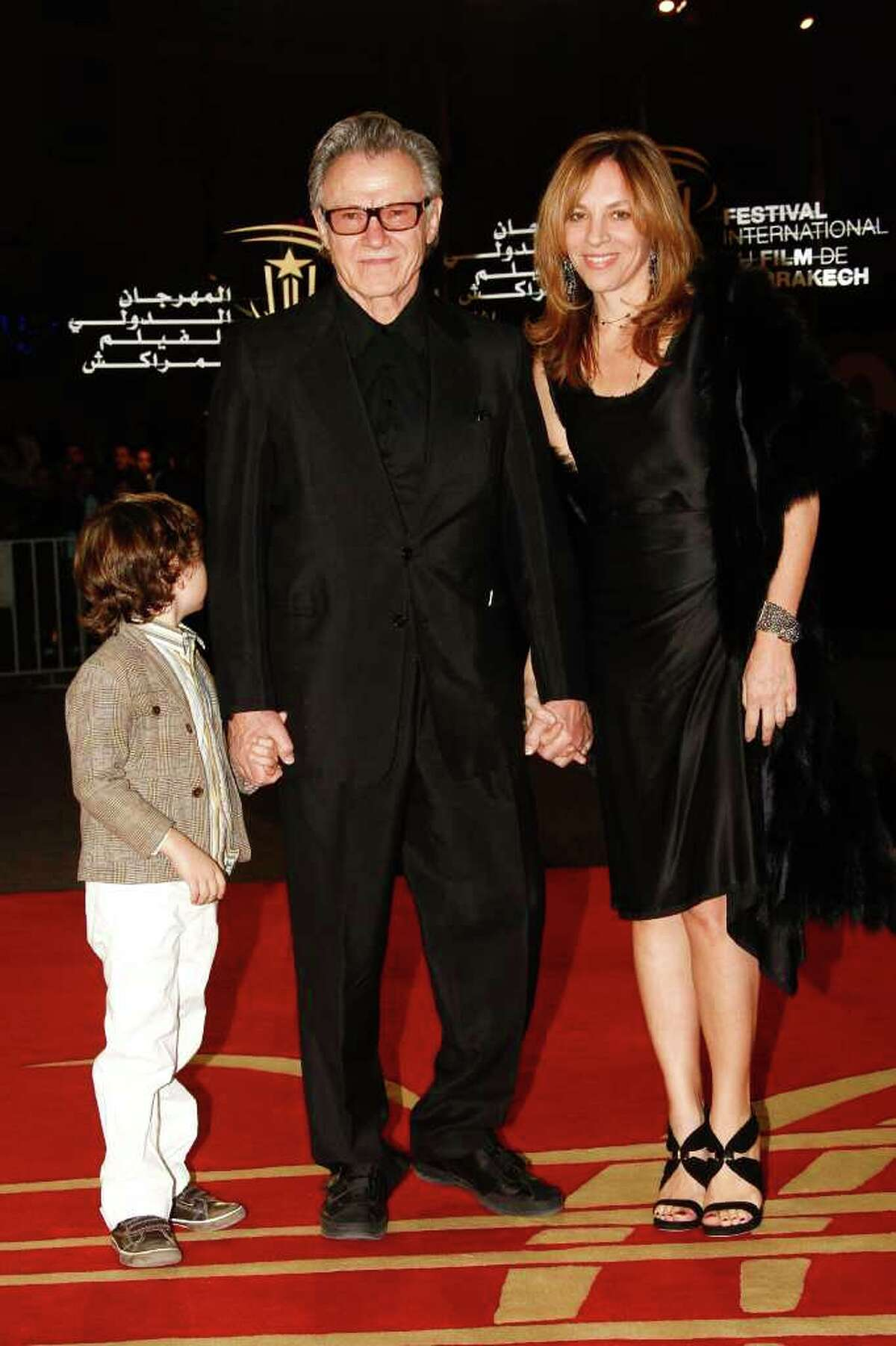 Us actor Harvey Keitel, center, arrives with his wife Daphna Kastner and son Roman, left, on the family arrival for a tribute to the American actor's career at the 10th Marrakech International Film Festival in Marrakech, Morocco, Wednesday Dec. 8, 2010. The Festival runs through Dec. 3-11. (AP Photo/Abdeljalil Bounhar)