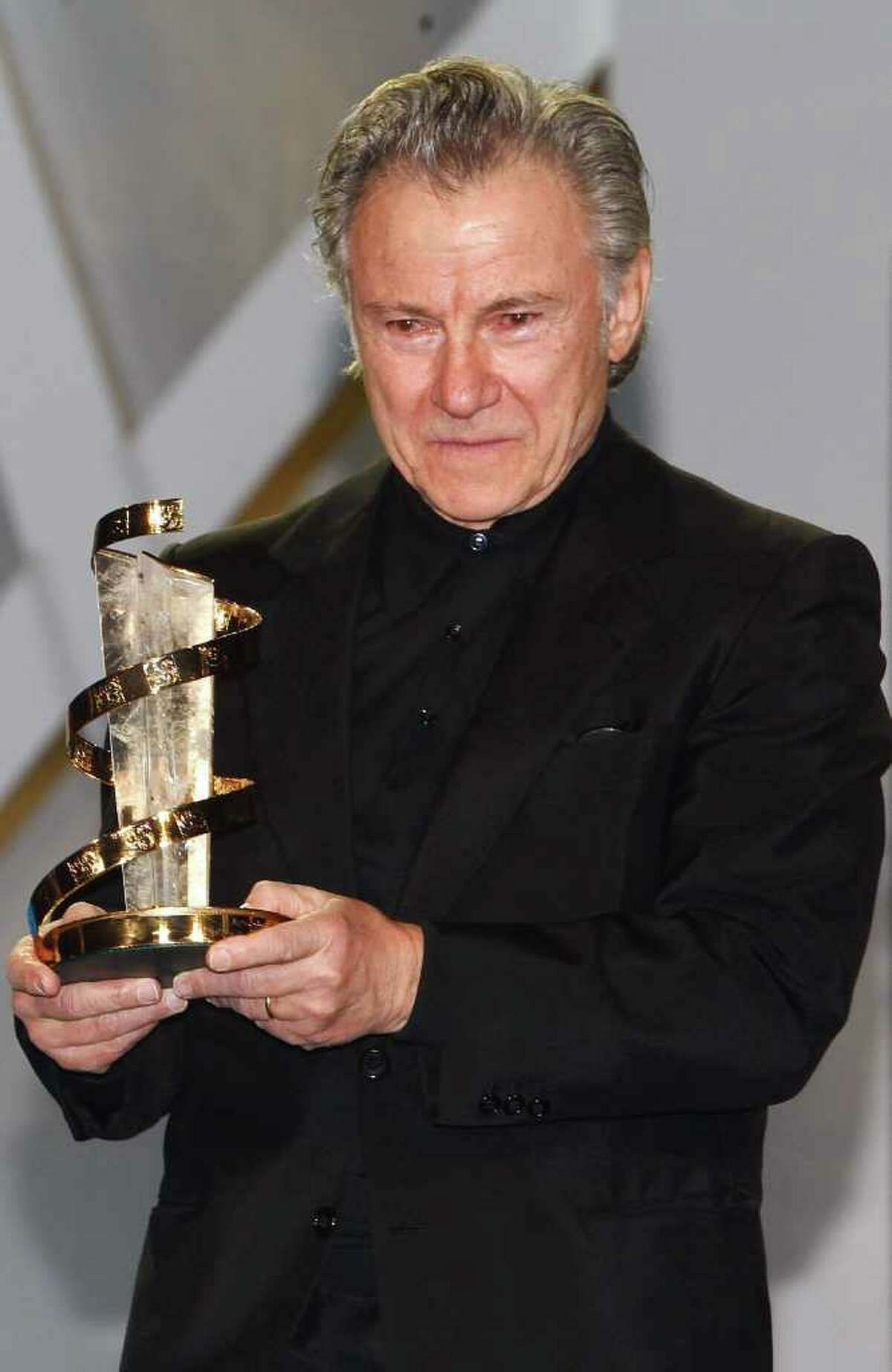 Us actor Harvey Keitel reacts, after receiving an award from US actress Susan Sarandon , during a tribute to his career, at the 10th Marrakech International Film Festival in Marrakech, Wednesday Dec. 8, 2010. The Festival runs through Dec. 3-11. (AP Photo/Abdeljalil Bounhar)