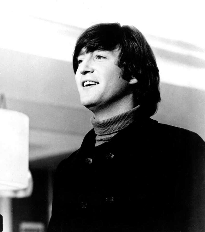 Beatle John Lennon is shown in this 1965 photo at an unknown location. (AP Photo)