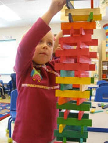 Emma Frank, 4, plays with Citi Blocks, which are designed to inspire open-ended play and creativity.