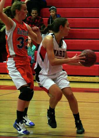 Fairfield Warde forward Brielle Lanese takes the ball to the basket on Danbury's Nicole Kline in the Hatters' 57-33 win over the Mustangs on Wednesday night at Fairfield Warde High School. Photo: Tim Parry / Fairfield Citizen freelance