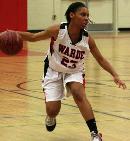 Fairfield Warde's Jamera Fountain takes the ball to the basket in Warde's 57-33 loss to Danbury on Wednedsday night in Fairfield. Photo: Tim Parry / Fairfield Citizen freelance