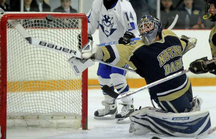 Notre Dame's goalie Eric Sugrue stretches out to intercept a wayward puck, during hockey action against West Haven in West Haven, Conn. on Wednesday Feb. 03, 2010. Photo: Christian Abraham, ST