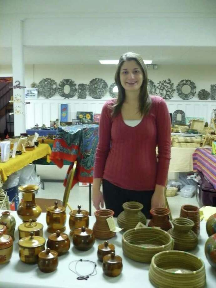 Fairfield University marketing student Janet Latuga sells pottery and other handcrafts made by people in Nicaragua as part of a fair-trade project she spearheaded. Photo: Contributed Photo / Fairfield Citizen contributed