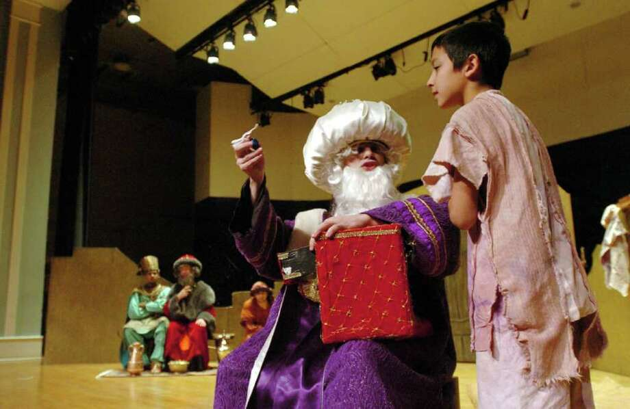 """David Sylvia, of Orange, left, as Kaspar, and Lucas Hernandez, 11, of Hamden, rehearse for """"Amahl and the Night Visitors"""" at Western Connecticut State University in Danbury, Dec. 8, 2010. Photo: Chris Ware / The News-Times"""