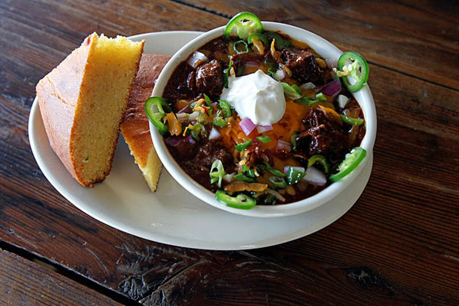 The restaurant serves its chili with a piece of cornbread. / © 2010 San Antonio Express-News
